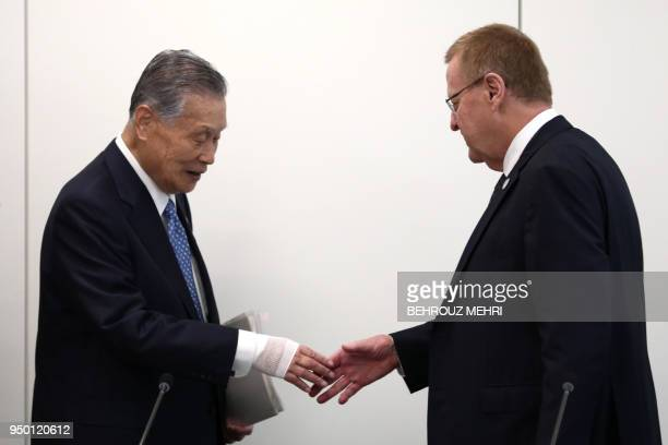 International Olympic Committee vice president and chairman of the Coordination Commission for Tokyo 2020 John Coates shakes hands with Tokyo 2020...
