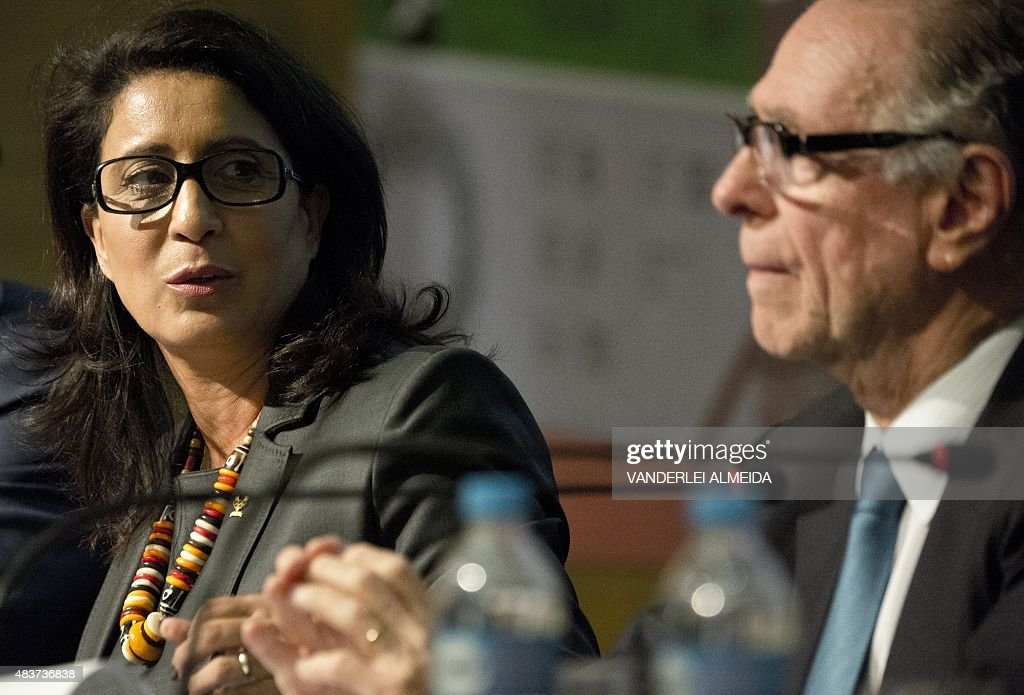 International Olympic Committee vice president Nawal El Moutawakel (L) and Brazilian Olympic Committee president Carlos Arthur Nuzman talk during a press conference in Rio de Janeiro, Brazil on August 12, 2015 to inform about the state of the works for the Rio 2016 Olympic Games.