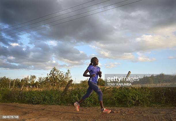International Olympics Committee 2016 olympics refugees team member Rose Nathike Lokonyen runs along a dirt road at a high altitude training camp, at...
