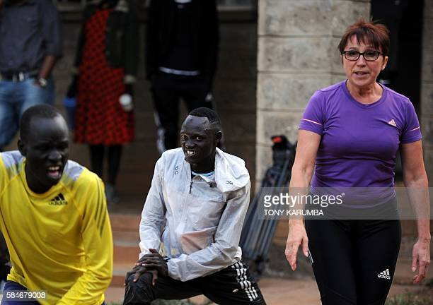 International Olympics Committee 2016 olympics refugees team members James Nyang Chiengjiek and Paulo Amotun Lokoro stretch during a physical...