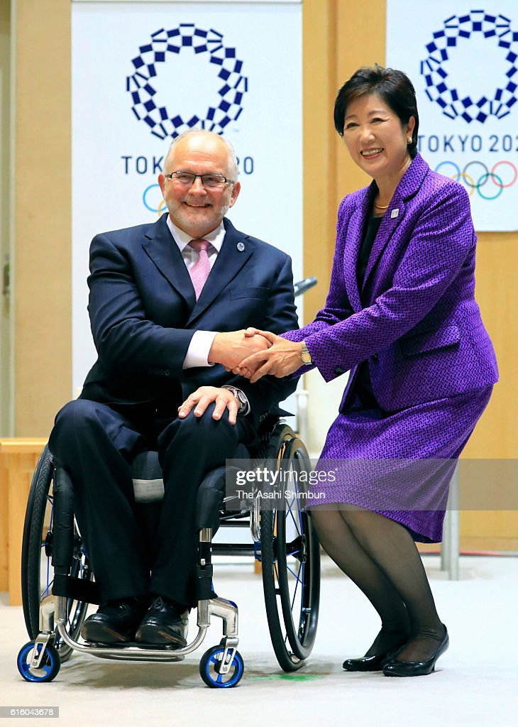 International Paralympic Committee President Philip Craven and Tokyo Metropolitan Governor Yuriko Koike shake hands during their meeting at Tokyo Metropolitan headquarters on October 21, 2016 in Tokyo, Japan.