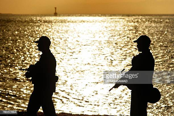 International peacekeeping soldiers from Australia patrol along the shore in Dili 08 August 2007 The former guerrilla leader Xanana Gusmao was sworn...