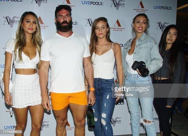 International personality Dan Bilzerian poses with models during a visit to India to announce his association with sports predictor LivePools and the...