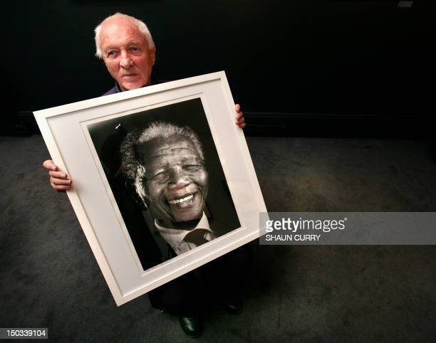 International photojournalist Jurgen Schadeberg poses for photographs with a portrait of Nelson Mandela at the Belgravia Gallery in central London,...