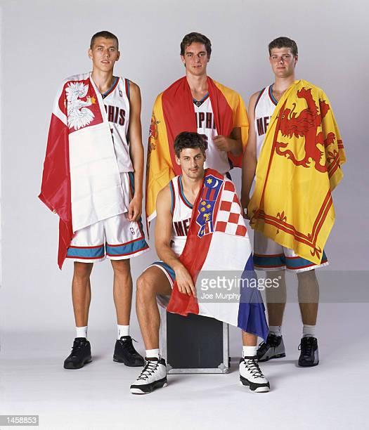 International players on the Memphis Grizzlies center Cezary Trybanski of Poland forward Pau Gasol of Spain forward Robert Archibald of Scotland and...