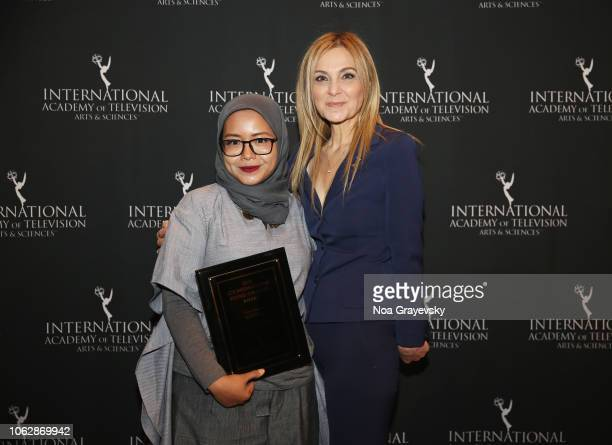 International President Michal Grayevsky poses with YCA Winner Puti Puar during the Young Creatives Awards Ceremony on November 16 2018 in New York...