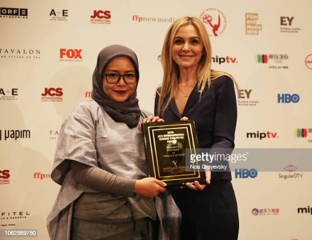 International President Michal Grayevsky speaks onstage with YCA Winner Puti Puar during the Young Creatives Awards Ceremony on November 16 2018 in...