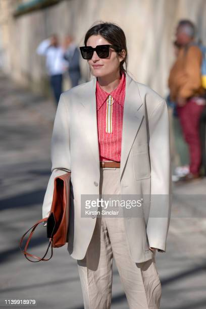 International producer for Vogue Ukraine Irina Linovich wears a Lemaire jacket, Margiela top, Acne trousers and a Celine bag and sunglasses on...