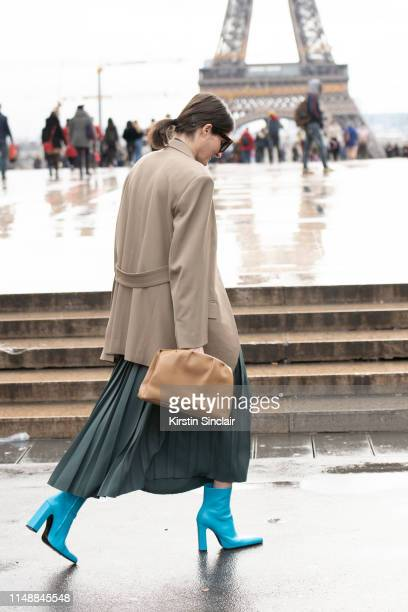 International Producer for Vogue Ukraine Irina Linovich wears a Joseph dress, Celine jacket and bag and Balenciaga boots on March 02, 2019 in Paris,...