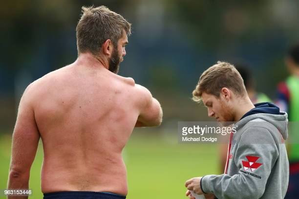 International recruit Geoff Parling of the Rebels looks down on his troublesome shoulder as he waits to have it restrapped during a Melbourne Rebels...