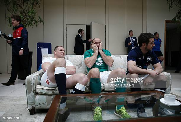 International rugby captains England's Dylan Hartley Ireland Rory Best and Scotland's Greg Laidlaw relax beside each other on a couch while they wait...