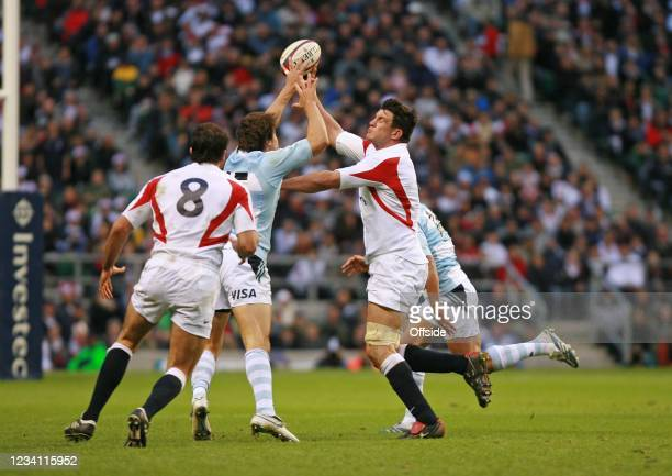 International Rugby, England v Argentina, England Captain Martin Corry tries to spread the ball wide.