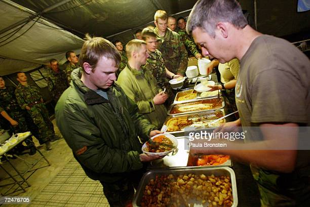 International Security Assitance Force line up to get their dinner February 25 2002 at the British military dinning hall on the base at Kabul...