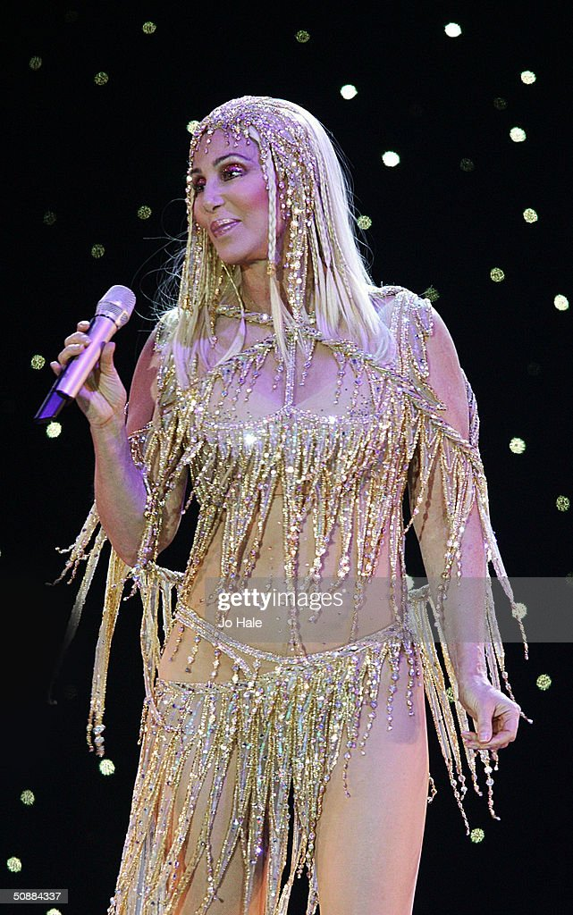 International singer and actress Cher performs on stage during her 'The Farewell Tour' on May 21, 2004 in London. The concert is one of Cher's final conerts in the UK.