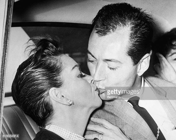 """International singing star Judy Garland kisses her American actor friend and """"escort"""" Mark Herron in a car at the airport here June 30th. The couple,..."""