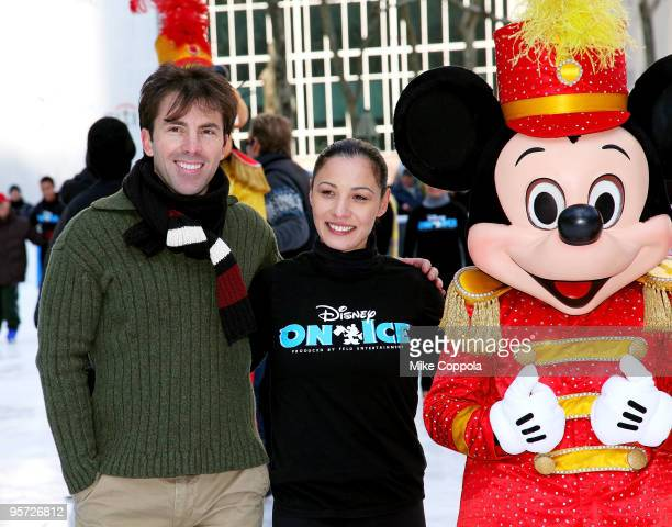 International skating champion Michael Weiss Olympian skater Natasha Kuchiki and Mickey Mouse attend the Disney On Ice Celebrates 100 Years Of Magic...