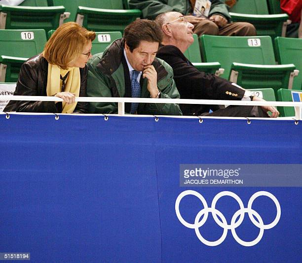 International Skating Union president Ottavio Cinquanta and his wife with Israel's Olympic Comittee member Alex Gilady watch the first compulsory...