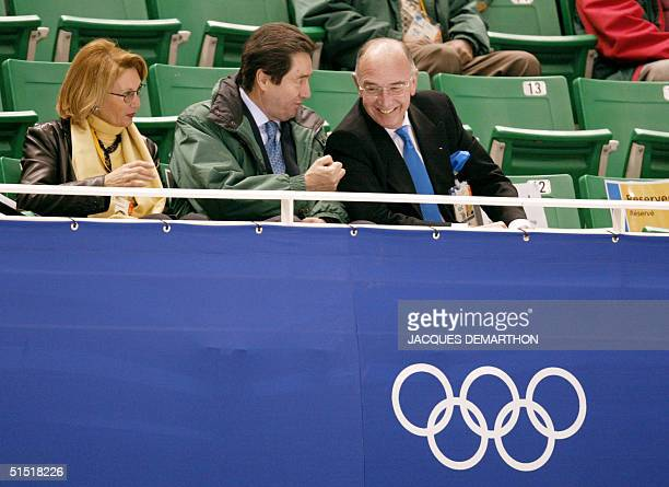 International Skating Union president Ottavio Cinquanta and Israel's International Olympic Comittee member Alex Gilady share a laugh as they watch...