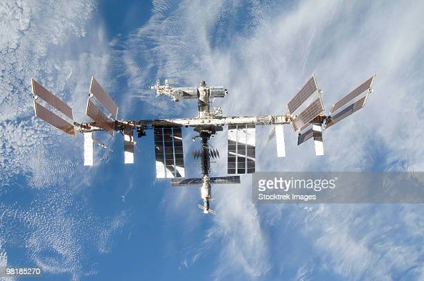international space station backdropped against earth. - international space station stock pictures, royalty-free photos & images
