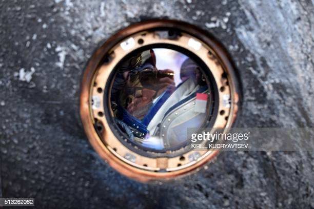 International Space Station crew member Mikhail Kornienko of Russia is seen inside the Soyuz TMA18M space capsule after landing near the town of...