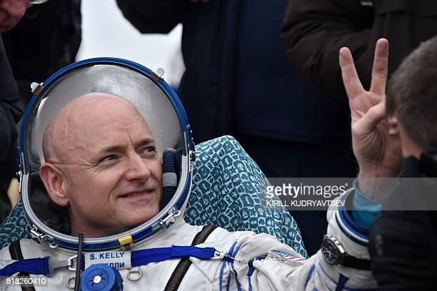 International Space Station crew member Scott Kelly of the US shows a victory sign after landing near the town of Dzhezkazgan Kazakhstan on March 2...