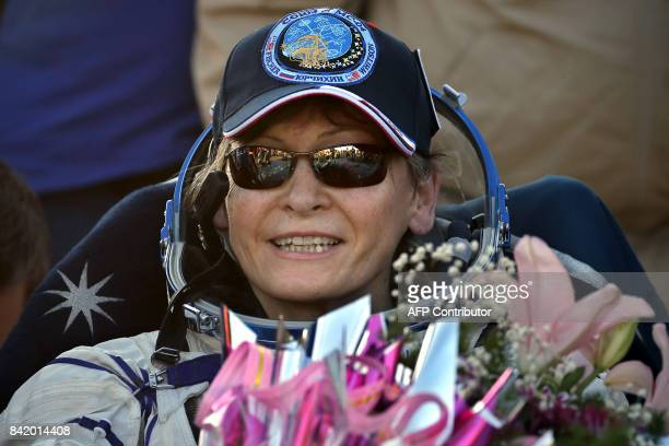 International Space Station crew member US astronaut Peggy Whitson rests shortly after landing in a remote area outside the town of Dzhezkazgan...