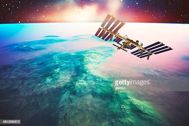 international space station orbiting earth like planet - international space station stock pictures, royalty-free photos & images