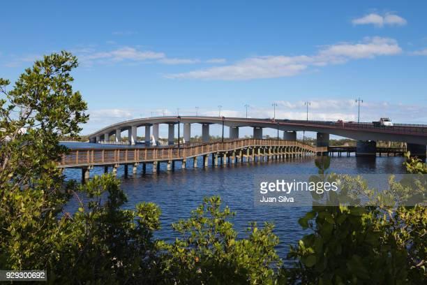 international speedway boulevard bridge seen from riverfront park, daytona beach, florida, usa - cocoa beach stock pictures, royalty-free photos & images