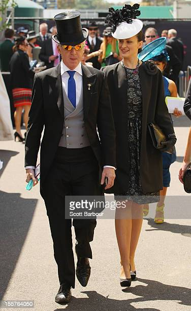 International Style Ambassador Philip Treacy and model Annaleise Smith attend Crown Oaks Day at Flemington Racecourse on November 8 2012 in Melbourne...