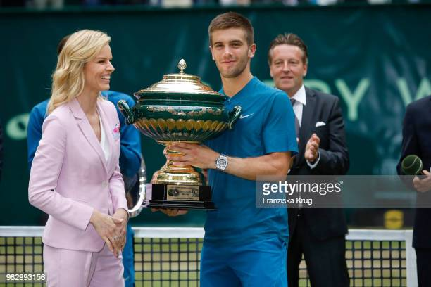 International supermodel Eva Herzigova hands the trophy to Borna Coric in the back Ralf Weber CEO Gerry Weber during the Gerry Weber testimonial at...