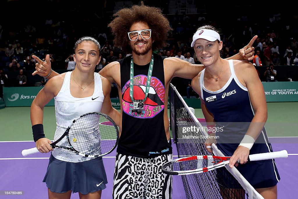 International superstar Red Foo poses with Sara Errani of Italy and Samantha Stosur of Australia after the coin toss for their match during the TEB BNP Paribas WTA Championships at the Sinan Erdem Dome October 25, 2012 in Istanbul, Turkey.