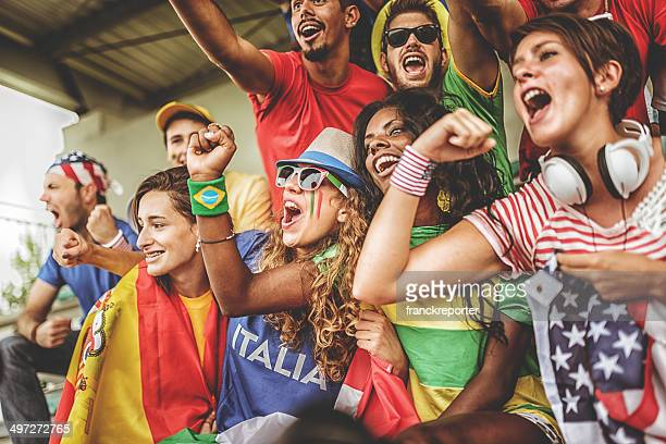 international supporters at stadium - hand fan stock photos and pictures