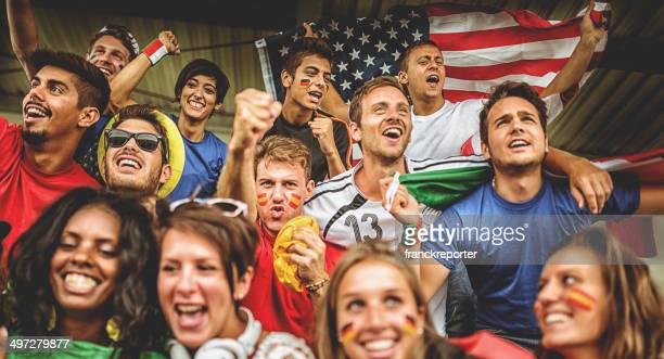 international supporters at stadium - hand fan stock pictures, royalty-free photos & images