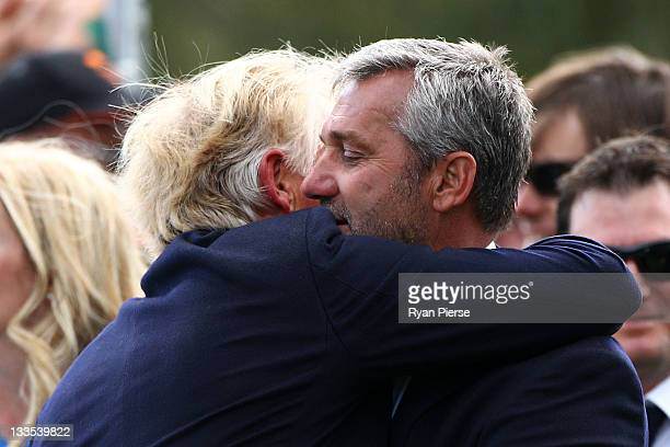 International Team captain Greg Norman embraces International Team captain's assistant Frank Nobilo at the closing ceremonies after defeating the...