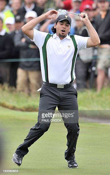 International Team member Jason Day of Australia reacts after missing a putt on the third day of the President's Cup golf tournament at the Royal...