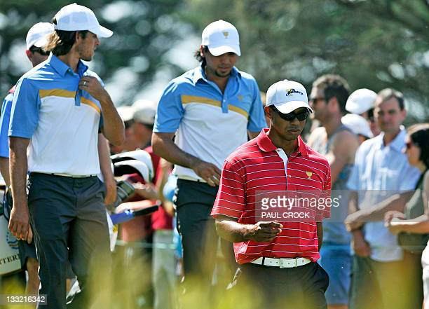 International Team members Aaron Baddeley and Jason Day of Australia follow Tiger Woods of the US team off a tee during the President's Cup...