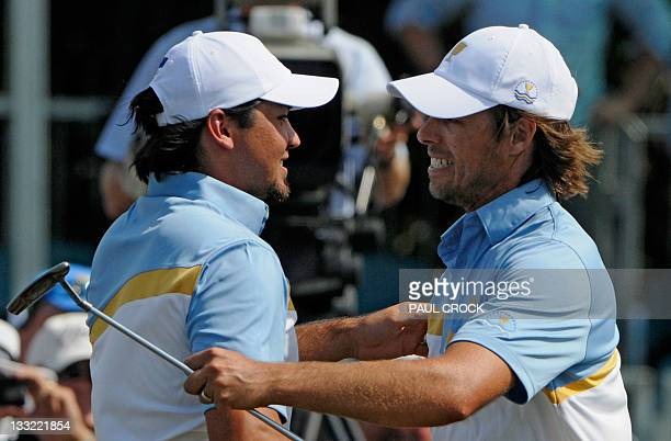 International Team members Aaron Baddeley and Jason Day of Australia celebrate their win over the US team pairing of Tiger Woods and Webb Johnson...