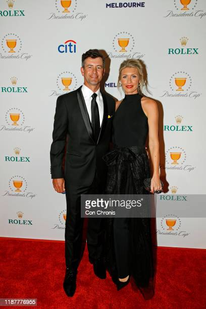 International Team player Adam Scott of Australia with is wife Marie Kojzar pose on the red carpet during the Presidents Cup Gala prior to Presidents...