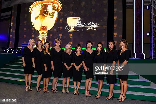 International Team players wives pose for a photo during The Presidents Cup Opening Ceremony at Songdo Convensia on October 7 2015 in Songdo IBD...