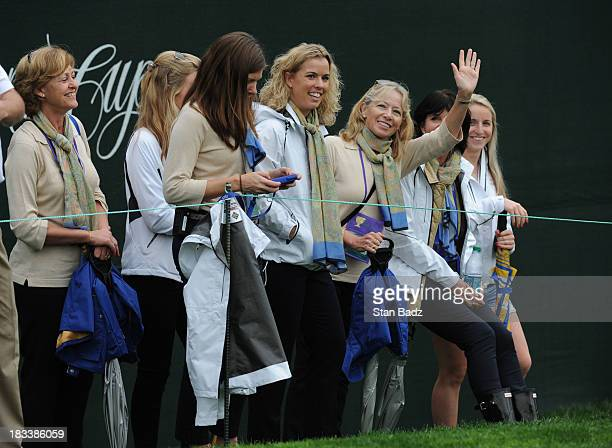 International Team wives and girlfriends follow the play during the Day Three FourBall Matches of The Presidents Cup at the Muirfield Village Golf...