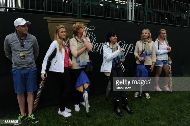 International Team wives and girlfriends follow the play on the first hole during the Day Three FourBall Matches of The Presidents Cup at the...
