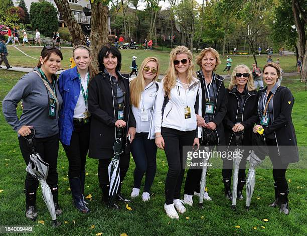 International Team wives and girlfriends pose for a photo during the Final Round Singles Matches of The Presidents Cup at the Muirfield Village Golf...