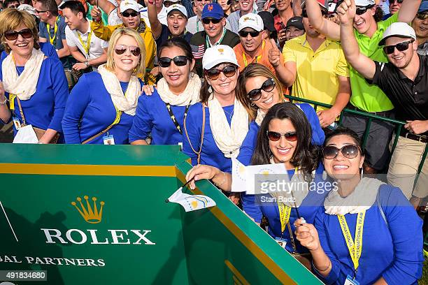 International Team wives and girlfriends watch play on the first hole tee box during the first round of The Presidents Cup at Jack Nicklaus Golf Club...