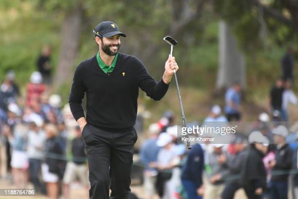 International Team's Adam Hadwin of Canada reacts to his putt on the fourth hole during the final round singles matches at the Presidents Cup at The...
