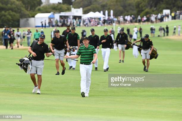 International Teams Cameron Smith of Australia and caddie Sam Pinfold during practice prior to Presidents Cup at The Royal Melbourne Golf Club on...