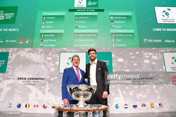 International Tennis Federation president David Haggerty and Barcelona's Spanish defender and Kosmos president Gerard Pique pose with the trophy in...