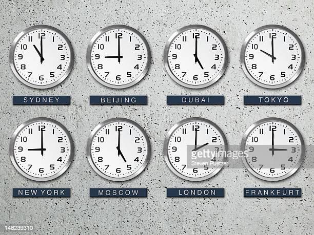 International time zone clocks on a concrete wall