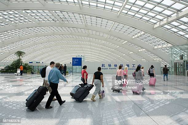International travellers arrive at the new Beijing Capital International Airport It is the world's largest airport building and the centerpiece of...