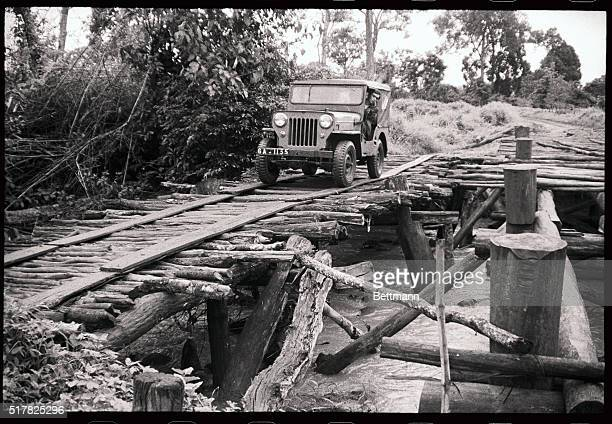 International Volunteer Service worker Kit Anderton cautiously edges his jeep across a rickety bridge leading to a Montagnard village in which...