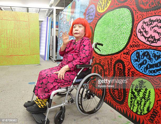 Internationally acclaimed artist Yayoi Kusama poses for photos following a press conference in Tokyo on Oct 27 which was held as she has been named...